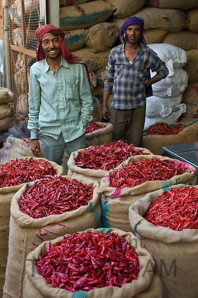 Porters at stall selling red chillies at Khari Baoli spice and dried foods market, Old Delhi, India