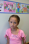 SAM_07921, Novartis, Russia, 2008, RUSSIA-10111. A young girl poses for a photo.