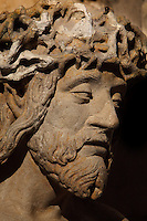 Christ of Pity, 16th century sculpture of Christ wearing the crown of thorns, in the Basilique Saint Remi or Abbey of St Remi, Reims, France. The 11th century, mainly Romanesque, church, contains the relics of St Remi, the Bishop of Reims, who converted Clovis, the King of the Franks, to Christianity in 496 AD. The abbey is a UNESCO World Heritage Site. Picture by Manuel Cohen