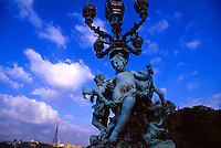 Statue on Pont Alexandre III (Eiffel Tower in background), Seine River, Paris, France..