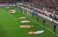 FUSSBALL   CHAMPIONS LEAGUE   SAISON 2011/2012  Achtelfinale Rueckspiel 13.03.2012 FC Bayern Muenchen - FC Basel  FC Bayern Muenchen Fahnenschwenker vor der Suedkurve warten auf ihren Einsatz
