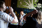 Sondre Lerche takes time between sets with his friends at Casino El Camino in downtown Austin, Texas during the 2011 SXSW Music Festival. Foreground left is Njal Leinan Clementsen and foreground right is Fredrik Vogsborg.