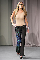Model walks runway in a one-of-a-kind artwear denim jeans, from the Jet Art Designs collection, by Princess Tarinan Von Anhalt, during Couture Fashion Week New York Fall 2012.