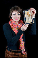 BNPS.co.uk (01202 558833)<br /> Pic: RachelAdams/BNPS<br /> <br /> ***Please use full byline***<br /> <br /> Auctioneer Amy Brennan holds the acrylic-encased poppy.<br /> <br /> <br /> The oldest surviving poppy from the bloody battlefields of the First World War has emerged for sale almost 100 years after it was first picked.<br /> <br /> The vivid red flower was taken from the front-line trenches of Arras in northern France by 17-year-old British soldier Private Cecil Roughton in 1916.<br /> <br /> The poppy is thought to be the oldest in Britain and one of only two that survived from the First World War.<br /> <br /> It is expected to sell for &pound;1,000 when it goes under the hammer at Duke's Auctioneers in Dorchester, Dorset.