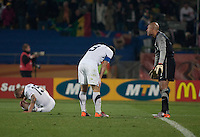 The USA' s (left to right) Jay DeMerit, Carlos Bocanegra,  and Tim Howard react to Ghana scoring their second goal in extra time of the 2010 second round World Cup match between USA and Ghana in Rustenberg, South Africa on Saturday, June 26, 2010.  Ghana won 2-1.
