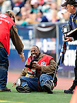 29 November 2009: Photographer Jerome Davis is helped up after getting hit on the sidelines during a game between the Miami Dolphins and the Buffalo Bills at Ralph Wilson Stadium in Orchard Park, New York. Davis was uninjured as the Bills defeated the Dolphins 31-14. Mandatory Credit: Ed Wolfstein Photo