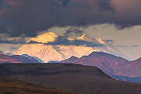 The north and south summits of Denali are visible under overlying clouds, Denali National Park.