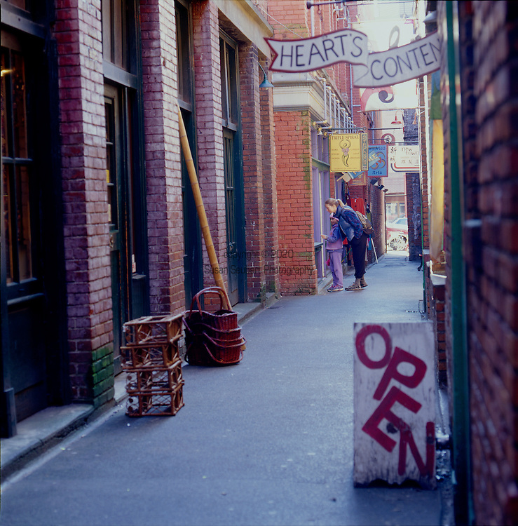 Fan Tan Alley is an alley in Victoria, British Columbia's Chinatown. It runs south from Fisgard Avenue to Pandora Avenue in the block between Government Street and Store Street. It was originally a gambling district with restaurants, shops, and opium dens. Today it is a tourist destination as it contains many small shops including a barber shop, art gallery, Chinese cafe and apartments. It is most famous for being the narrowest street in Canada. At its narrowest point it is only 0.9 metres wide