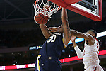 25 January 2015: Notre Dame's Zach Auguste (30) dunks the ball on NC State's Kyle Washington (right). The North Carolina State University Wolfpack played the University of Notre Dame Fighting Irish in an NCAA Division I Men's basketball game at the PNC Arena in Raleigh, North Carolina. Notre Dame won the game 81-78 in overtime.