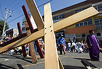 A Nazareno takes a break next to crosses as he makes his way to the top of Iztapalapa hill where Jesus Christ will be hanged on a cross, April 14, 2006. Almost a million people attend the procession of Good Friday in this  neighborhood of Mexico City, where for o163 years the Iztapalapa neighborhood residents have taken part in a re-enactment of Christ's crucifixion.  Photo by © Javier Rodriguez