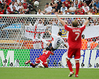 John Terry (6) of England hooks Trinidad's Stern John's (14) header off the goal line. England defeated Trinidad & Tobago 2-0 in their FIFA World Cup group B match at Franken-Stadion, Nuremberg, Germany, June 15 2006.