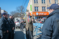 NY Senator Charles Schumer greets police officers Eighth Avenue in the Sunset Park neighborhood in Brooklyn in New York on Sunday, February 28, 2016 during the Lantern Festival street fair. Sunset Park has become Brooklyn's Chinatown as Chinese and other Asian groups have moved there and businesses have sprouted up to cater to them. (© Richard B. Levine)