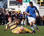 Nathan Sharp goes in on Lee McCulloch and the ball breaks to Kal Naismith to score