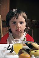 Ile D'Orleans, Quebec City Area, Canada, June 8, 1984. Child having breakfast.
