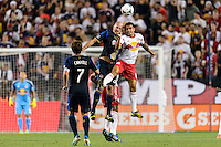 Conor Casey (6) of the Philadelphia Union goes up for a header with Tim Cahill (17) of the New York Red Bulls during a Major League Soccer (MLS) match at Red Bull Arena in Harrison, NJ, on August 17, 2013.