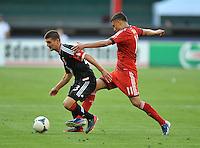 Perry Kitchen (23) of D.C. United goes against Luis Silva (11) of Toronto FC. Toronto FC defeated D.C. United 2-1, at RFK Stadium, Saturday June 15 , 2013.