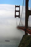 A rare afternoon brought a white backdrop of fog to the Golden Gate Bridge in San Francisco, California.