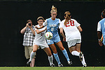07 September 2014: North Carolina's Cameron Castleberry (21) is defended by Arkansas' Kaylyn Cooper (18) and Margaret Power (28). The University of North Carolina Tar Heels played the University of Arkansas Razorbacks at Koskinen Stadium in Durham, North Carolina in a 2014 NCAA Division I Women's Soccer match. UNC won the game 2-1.