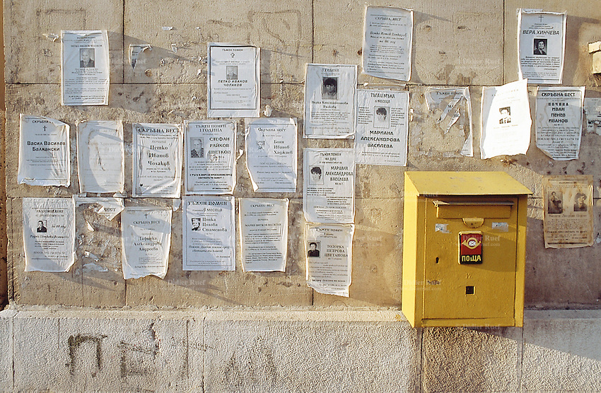 Bulgaria. Province Oblast Lovech. Lukowit. An official yellow letterbox and various announcement of death are on the wall. © 1997 Didier Ruef