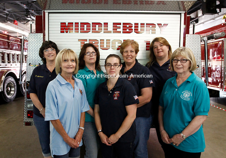 Middlebury, CT- 11 July 2014-071114CM06- The Middlebury Volunteer Fire Department's Ladies Auxiliary front row from left to right, Beverly Dassonville, Kristine Boisits and Jean Daws.  Back row from left to right, Marie Michaud, Beth Jungen, Barbara Fecteau and Kristin Kales.  The ladies ensured firefighters battling last week's mansion fire on Breakneck Hill Road were hydrated with water and Gatorade and prepared food for them at the firehouse.   Christopher Massa Republican-American