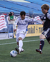 San Jose Earthquakes midfielder Joey Gjertsen (17) holds off New England Revolution defender Seth Sinovic (27) as he dribbles towards the Revolution corner.  The New England Revolution and San Jose Earthquakes play to a scoreless draw at Gillette Stadium on May 15, 2010