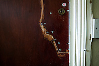 Hamid is now on support from section 4 of the Immigration and Asylum Act 1999 after repeated suicide attempts and this is the door to his room at the no choice accomodation he has been given. He spent three years living on buses, in parks and on the streets of London, using heroin to self-medicate the after effects of being tortured in prison for over a year in his homeland. Hamid's father ran a large and successful building and car business in Iran, the family was wealthy and after leaving school he worked for his father. He became involved in a political movement that opposed the government and as a result was detained and tortured. Hamid's brother was hanged due to his anti-government political activity. Hamid however managed to escape to the UK, and after his asylum claim was refused he became destitute and started sleeping rough. Hamid is one of an estimated 300,000 rejected asylum seekers living in the UK.