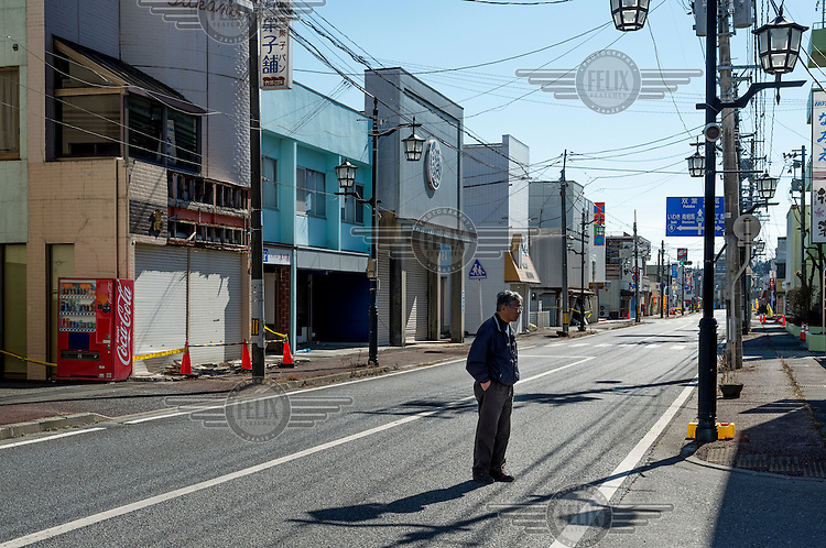Kamakura Toyotaka, 65, standing on a street in the city of Namie where he had ran what was considered the town's best florist's shop. Following the 2011 Fukushima Daiichi nuclear disaster the town's 19,000 residents were evacuated and today it remains a ghost town.  On 11 March 2011 a magnitude 9 earthquake struck 130 km off the coast of Northern Japan causing a massive tsunami that swept across the coast of Northern Honshu damaging the Fukushima Daiichi nuclear power plant and triggering the worst nuclear accident since Chernobyl. The plant was shut down and a 20 km evacuation zone around the plant was declared by the government. Levels of radiation in the evacuation zone remain high. .
