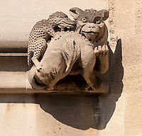 Gargoyle below Magdalen Great Tower, part of Magdalen College, Oxford University, England.