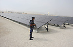 A Palestinian security officer stands guard near the solar power station in the West Bank city of Jericho on September 30, 2012. Photo by Issam Rimawi
