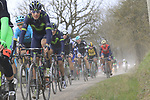 The peloton on gravel sector 4 Commune di Murlo during the 2017 Strade Bianche running 175km from Siena to Siena, Tuscany, Italy 4th March 2017.<br /> Picture: Eoin Clarke | Newsfile<br /> <br /> <br /> All photos usage must carry mandatory copyright credit (&copy; Newsfile | Eoin Clarke)