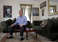 NWA Democrat-Gazette/DAVID GOTTSCHALK - 4/22/15 - Rafael Arciga sits in his favorite personal space, the living room area of his house in Fayetteville.