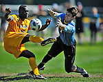 18 September 2011: University of Vermont Catamount Defender Yannick Lewis, a Senior from Toronto, Ontario, battles Harvard University Crimson Goalkeeper Austin Harms, a Senior from Corona del Mar, CA, at Centennial Field in Burlington, Vermont. Lewis scored the games' lone goal as the Catamounts shut out the visiting Crimson 1-0, earning their 3rd straight victory of the 2011 season. Mandatory Credit: Ed Wolfstein Photo