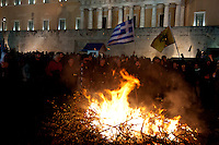 Fire set by angry farmers outside the parliament during a protest against planned pension reforms in Athens February 12, 2016. <br /> Farmers from across Greece gather in Athens for a two-day protest against the government and its plans to impose new tax hikes and pension charges.