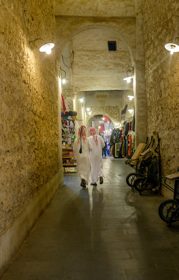 DOHA, QATAR - CIRCA DECEMBER 2013: People walking over at the Souq Waqif. This is a popular and traditional market bazaar in Doha.