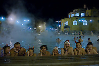 "Participants of the half naked ""Santa run"" enjoy the 38 degree celsius thermal pool of Szechenyi bath in Budapest, Hungary on December 11, 2011. ATTILA VOLGYI"