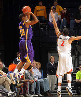 Jan. 2, 2011; Charlottesville, VA, USA; LSU Tigers guard Ralston Turner (22) shoots over Virginia Cavaliers guard Mustapha Farrakhan (2) during the game at the John Paul Jones Arena. Virginia won 64-50. Mandatory Credit: Andrew Shurtleff-