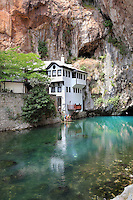 Blagaj Tekke, a Sufi monastery at Vrelo Brune, the Buna river spring near Blagaj village, near Mostar, Bosnia and Herzegovina. The early 16th century Ottoman monastery complex includes a musafirhana or guest house and turbe or mausoleum, built in the limestone cliffs at the point where the spring emerges from a cave. Picture by Manuel Cohen