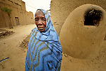 Mariam Mohammed is a woman who fled Timbuktu, a city in northern Mali, when it was seized by Islamist fighters in 2012. She returned home in May, 2013, after the city and region had been liberated by French and Malian soldiers.