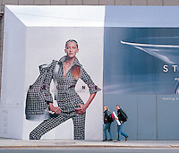 """Out takes from """"The Harvard Design School Guide to Shopping"""" published by Tashen. A huge advertisement on the upper east side is put into perspective by two pedestrians walking infront of it. NY 2000"""