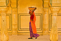 Women walking through arches at the Amber Palace, Amber (near Jaipur), Rajasthan, India
