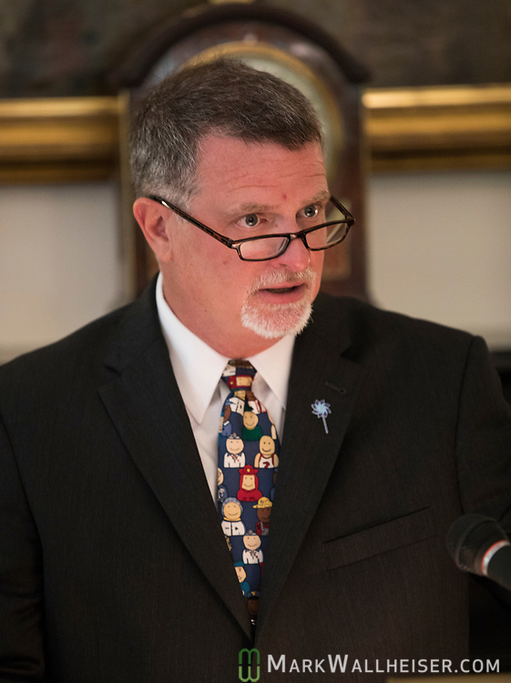 """Chris Lolley, Executive Director, Prevent Child Abuse speaks during a press conference to launch Prevent Child Abuse with Florida's annual """"Pinwheels for Prevention"""" campaign at the Florida Governor's Mansion."""
