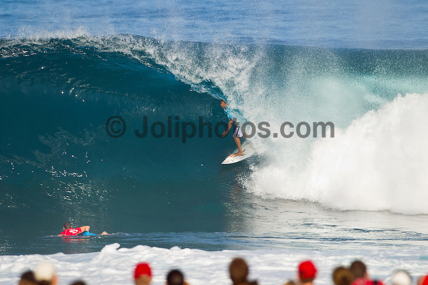 PIPELINE, Oahu/Hawaii (Thursday, December 16, 2010) Dane Reynolds (USA) and Taylor Knox (USA). - Jeremy Flores (FRA) 22, won the Billabong Pipe Masters in memory of Andy Irons over Kieren Perrow (AUS), 33, in a come-from-behind victory in firing four-to-six foot (1.5 metre) backdoor barrels, marking his first career ASP World Tour victory...Joel Parkinson (AUS), 29, was another to stand atop the Billabong Pipe Masters podium, clinching his third, consecutive Vans Triple Crown title to conclude the 2010 ASP World Tour season...Flores, who was in need of a solid 8.60 single-wave score in the dying moments, clawed his way back into the Final against Perrow and threaded the needle on a beautiful righthand barrel to earn a 9.37. Making history as the first European to ever win the Billabong Pipe Masters in the event's 40 year history, Flores punctuated his season with his career-best result..Photo: joliphotos.com