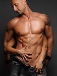Woman's hands touching young muscular man's body