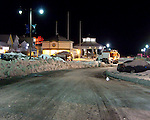 Snow coats the street, sidewalks, and everything nearby at night just after the the blizzard of February 2010 ended in Rehoboth Beach, Delaware, USA.