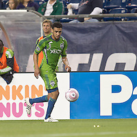 Seattle Sounders midfielder Lamar Neagle (27) dribbles. In a Major League Soccer (MLS) match, the Seattle Sounders FC defeated the New England Revolution, 2-1, at Gillette Stadium on October 1, 2011.