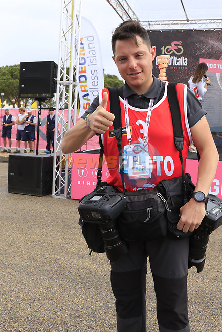 Photographer Fabio Ferrari at sign on before Stage 2 of the 100th edition of the Giro d'Italia 2017, running 221km from Olbia to Tortoli, Sardinia, Italy. 6th May 2017.<br /> Picture: Eoin Clarke | Cyclefile<br /> <br /> <br /> All photos usage must carry mandatory copyright credit (&copy; Cyclefile | Eoin Clarke)