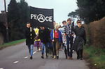 "Young Anarchist Peace Demonstrators march from  Aldermaston to Greenham Common Easter 1983. Peace demonstrators formed a human chain stretching 14 miles. They lined a route along what the protesters call ""Nuclear Valley"" in Berkshire. The chain started at the American airbase at Greenham Common, passed the Aldermaston nuclear research centre and ended at the ordnance factory in Burghfield."