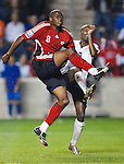 Cyd Gray (8) TT and DaMarcus Beasley (17) US.The U.S. Men's National Team defeated Trinidad & Tobago 3-0 at Toyota Park in Bridgeview, IL on September 10, 2008.