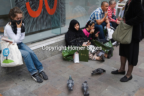 Tourists in Knightsbridge London 2009. Outside Harrods department store.