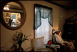 Lateef Muhammed, 76 relaxes at the end of the day. His wife Florence, and granddaughter Kelly are reflected in the mirror. They live in a mostly Sunni farming village called New Medinah. Near Sumrall, Mississippi, USA, November 2002